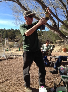 Arborist Cheyenne Thomas, teaching the second pruning workshop at a participant's house.